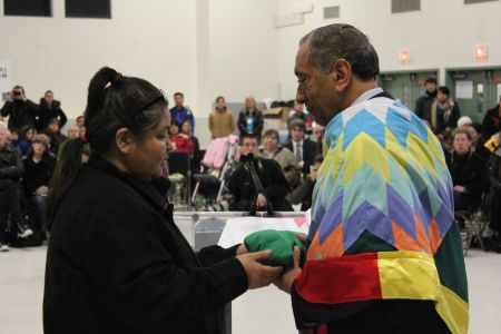 Kelly White presents Commissioner Wally Oppal with a bundle. Photo: Tami Starlight