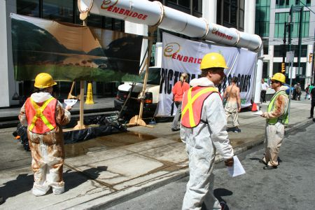 "Oil soaked ""mock Enbridge workers"""
