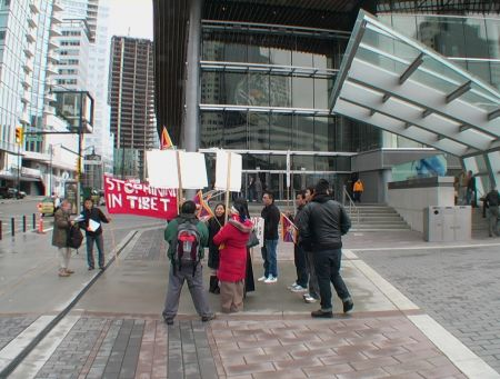 Protestors with Banners and Signs Outside the Convention Centre