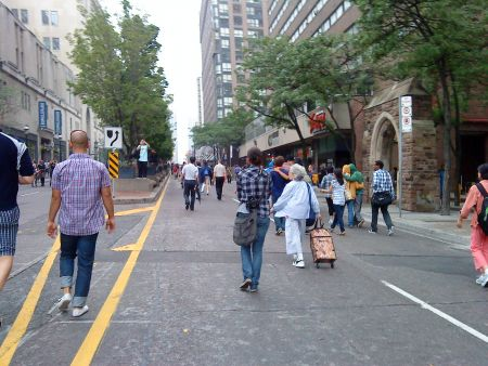 People wandering around on a nearly-car-free Yonge St. after the protest