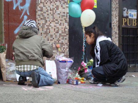 Mourners kneel before a vigil for Verna Simard //dp