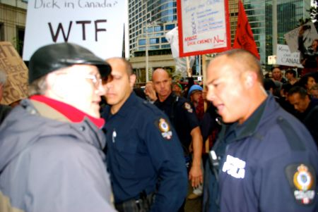 Protestor and police officer
