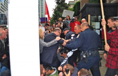 Attempts to cross protest line into back door of the 'Vancouver Club'