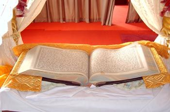 The Guru Granth Sahib Ji ( the holy scripture of the Sikhs) The Sikhs consider the Guru Granth Sahib as their living Guru and treat it with the utmost respect and reverence. The central theme of the Guru Granth Sahib Ji revolves around  equality and oneness of society regardless of  cast, color, creed, religion, socioeconomic status.