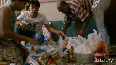 Kurdish immigrants sort donations made by an Athens solidarity group