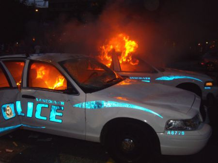 Two cops cars up in flames, June 15, 2011