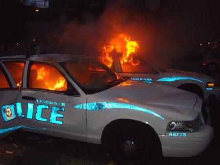 Vancouver police vehicles burn during Canucks Riot, June 15, 2011