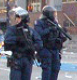 VPD public order unit members during Canucks riot, armed with M4 and Arwen
