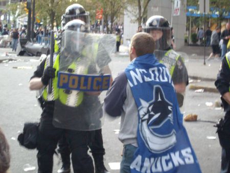 Captain Canuck confronts riot cops June 15, 2011