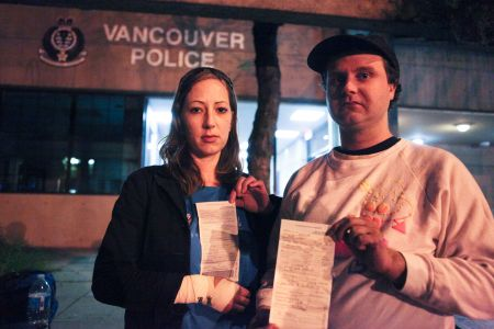 Sasha Wiley-Shaw and Peter Haywood display their charge sheets after their release. Photo by David P. Ball