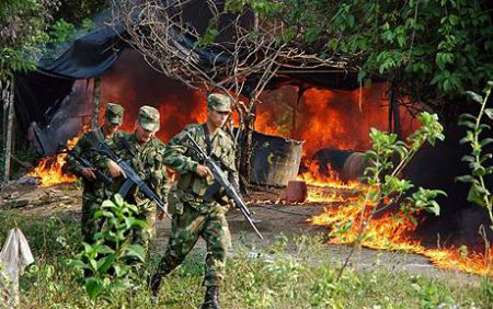 Colombia: paramilitary forces raze village infrastructure. Photo from UK Telegraph.