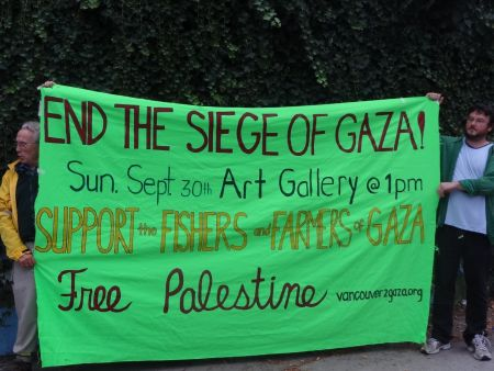 Local activists display banner and plan Sunday rally against Israeli attacks on Gaza fishers and farmers