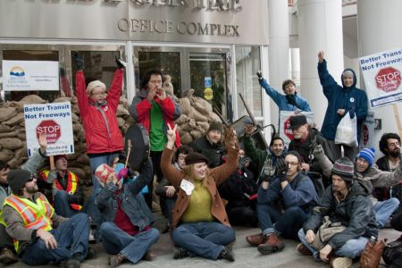 Climate Justice rally in Vancouver sandbags office of BC premier and cabinet. Photo: Erin Empey