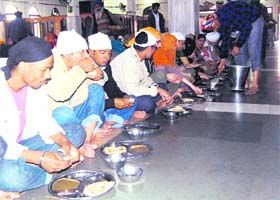 The langar hall (community kitchen) at the Golden Temple. To further the concept of an equal and  harmonious multifaith and multicultural  society, the Sikh Gurus created the concept of langar or community kitchen. The langar is a place where people from all walks of life are welcome to sit together and share a common meal.