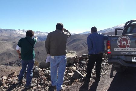Three men from the Diaguita Huascoaltinos Indigenous and Agricultural Community overlook the area which would be destroyed by the El Morro mine in Chile. Photo: Sergio Campusano.