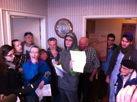 Tenants hold up the letter they received from the Mount Pleasant Housing Society