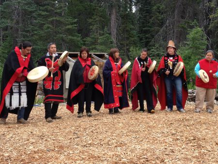 Members of the Wet'suwet'en nation perform a welcoming song to open the 4th annual Unis'tot'en action camp. Photo: Aaron Lakoff