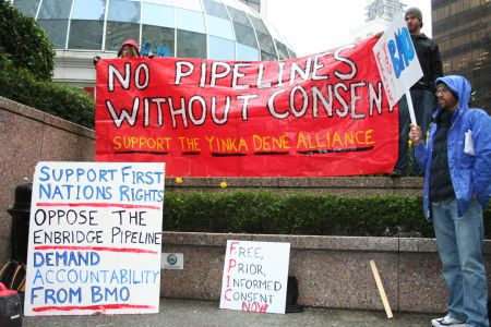 NO PIPELINES WITHOUT CONSENT banner in support of the Yinka Dene Alliance. March 22, 2011. Photo: Sandra Cuffe