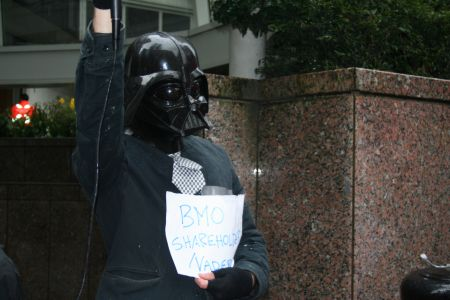 """BMO shareholder Vader"" makes a surprise appearance at the rally outside the Four Seasons hotel. Vancouver, March 22, 2011. Photo: Sandra Cuffe"