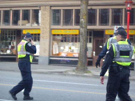 These are two commanders of the PSU (both Sergeants) and a member of the fire department (with red lettering on the back of his reflective vest).  The fire department is also part of the PSU.