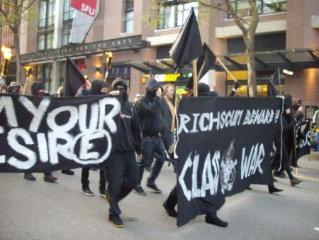 Members of the black bloc and their banners.