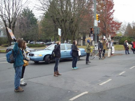 Another view of the circle at University and Westbrook, with blue unmarked RCMP vehicle lurking in the background.
