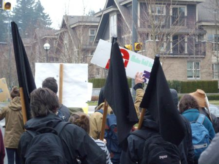 Anarchist black flags on the march.