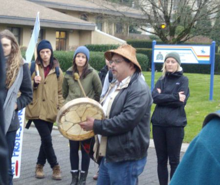 Musqueam singer outside UBC RCMP station.