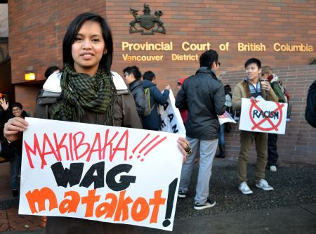 "Krystle Alarcon of the Philippine Women's Centre led the rally in this Tagalog chant, which roughly translated means ""Dare to struggle, never be afraid!"" <i>murray bush - flux photo</i>"
