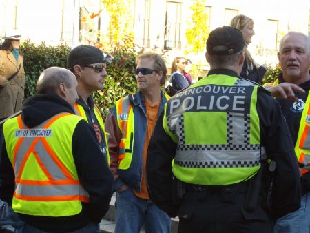 City of Vancouver workers and police, hand in hand
