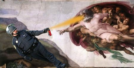 pepper spray riot cop god