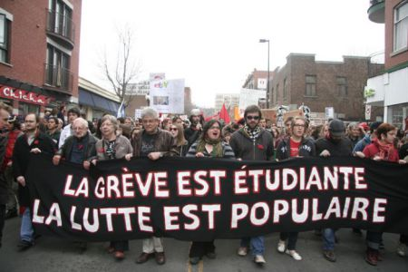 "Protesters march in Montreal, ""The student strike is a popular struggle"" reads the banner."