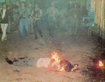 A Sikh youth being burned alive during the Sikh Genocide in India in 1984.