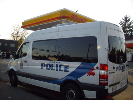 Cops at first parked their riot squad van in one of the Shell station driveways.