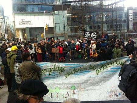 Over 100 people rally outside Apache offices in Vancouver in support of Unist'ot'en.