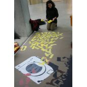 Alejandra enjoying her creativity with the banner