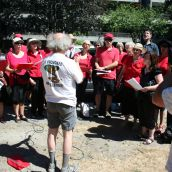 warming up with the choir before heading out on the march