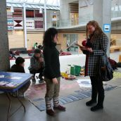 Alejandra connects with SFU student and hands her information