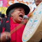 Downtown eastside activist sings a First Nation song at the rally