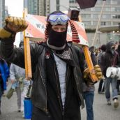 Anti-Olympic activist raises his fist in resistance to the 2010 Winter Games