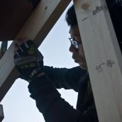 worker building a shelter