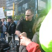 A police line set up near Canada Place in front of the bus carrying delegates that the protesters blocked