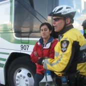 Police forcibly removed protesters standing next to the bus