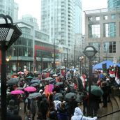 Many people braved the rain to attend the Vancouver rally in support of the uprisings in Egypt, Tunisia, and beyond. Photo: Sandra Cuffe