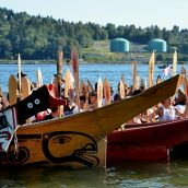 Canoes arrive at Whey-Ah-Wichen - Kinder Morgan pipeline facility in backround
