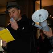 SFU English Dept. prof Steve Collis reads one of his open poems to Goldcorp