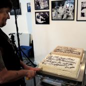 Activist Dean Wilson cuts the cake