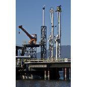 Greenpeace members atop a Kinder Morgan dockside oil pump