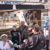 Downtown Eastside (DTES) residents gathered outside the Pantages demolition site on Monday, July 16 to draw attention to rats and rubble disaster that festered in their community for over a year, and to demand action from the City of Vancouver. Photo credit: Downtown Eastside Not for Developers Coalition