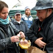 Chief Roland Willson presents gifts to hunger striker Kristin Henry